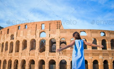 Young woman in front of colosseum in rome, italy