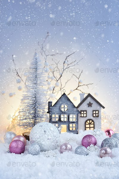 Christmas composition with festive decorations оn the snow. New Year greeting card.
