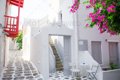 The narrow streets with blue balconies, stairs, white houses and flowers in beautiful village in