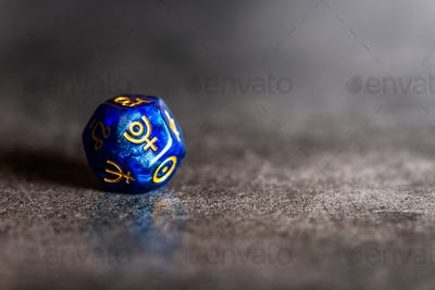 Astrology Dice with symbol of the planet Pluto