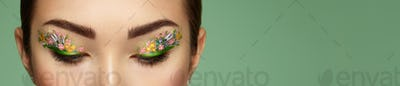 Eye makeup girl with a flowers