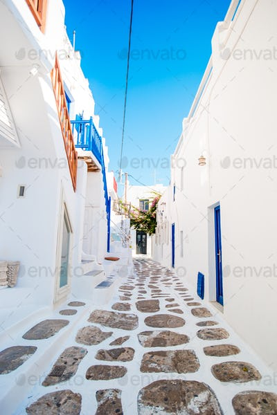 Empty narrow streets of greek old village. Beautiful architecture building exterior with cycladic
