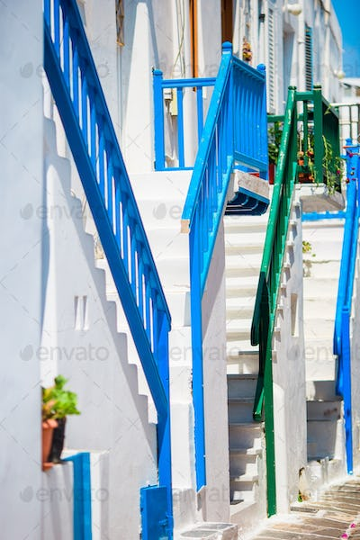 Empty narrow streets of greek island with trees. Beautiful architecture building exterior with