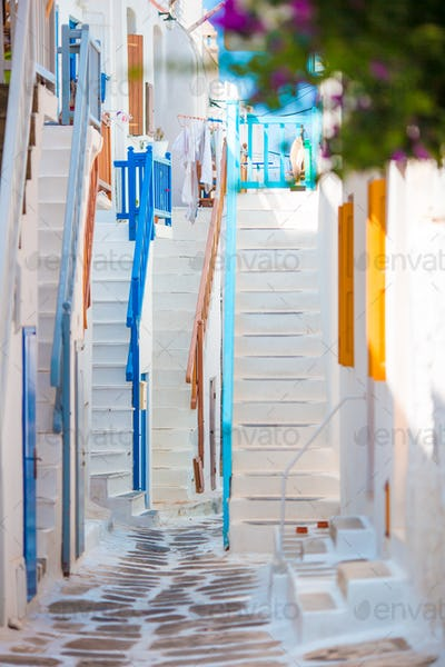 Colorful stairs on old narrow streets of greek island. Beautiful architecture building exterior with