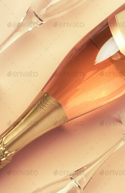 Bottle with pink sparkling wine or rose champagne