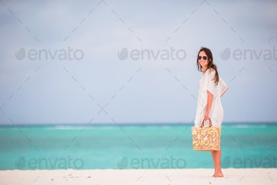 Young beautiful woman during tropical beach vacation