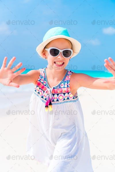 Portrait of adorable little girl at beach during summer vacation