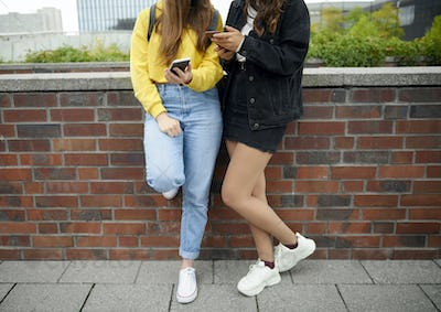 Modern young girls using mobile phone