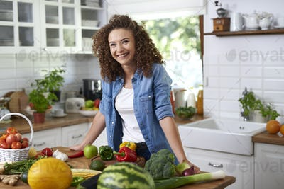 Portrait of smiling young woman in domestic kitchen