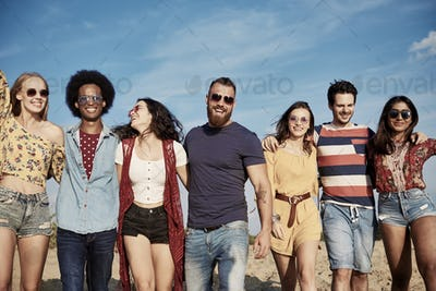 Young smiling people in a row on the fresh air