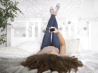 Rear view of  teenage girl making a selfie