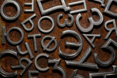 Assorted metal cyrillic letters on a rusty background
