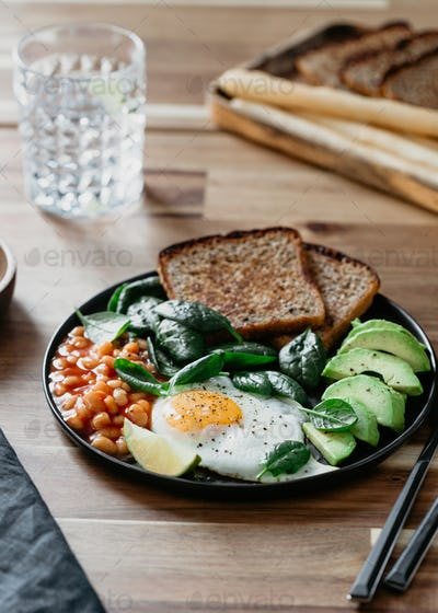 Healthy breakfast or lunch at home or cafe with fried egg