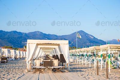 Sunbeds in famous italian sand beach at Forte dei Marmi