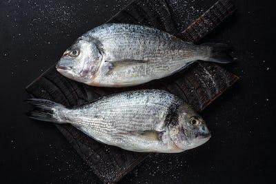 Fresh dorado fish with ingredients