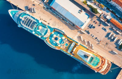 Aerial view of swimming pool, sunbeds, umbrellas on cruise ship