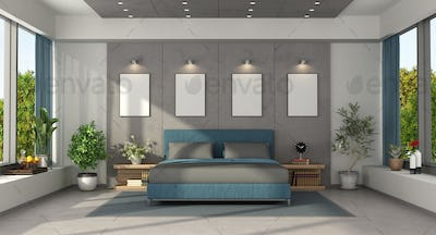Modern master bedroom with blue double bed