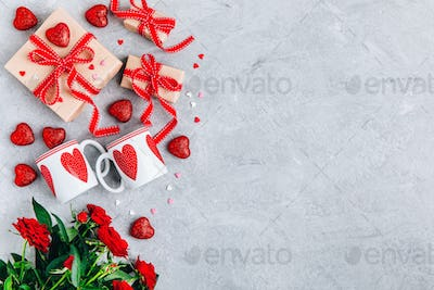 Valentine Day background with red hearts, gift boxes with red ribbons and red roses.