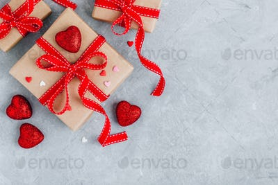 Valentine Day background with red hearts, gift boxes with red ribbons.