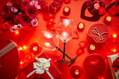 Valentines day romantic decoration with roses, wine glasses, boxed gifts, candles
