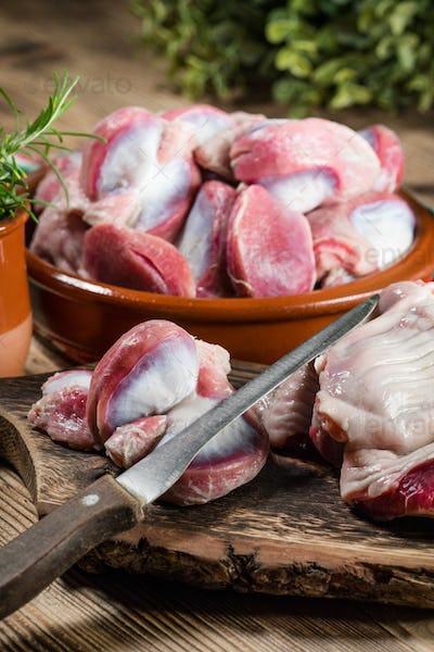 Raw uncooked turkey gizzards.