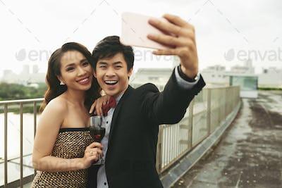 Loving Couple Taking Selfie Outdoors