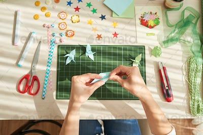 Creative Woman Making Origami Cranes