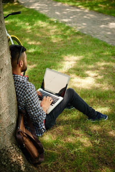 Young Freelancer Working at Green Park