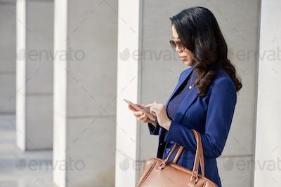 Confident Businesswoman Standing Outdoors