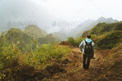 Santo Antao Island, Cape Verde. Man tourist traveler with backpack enjoying rural landscape of Paul