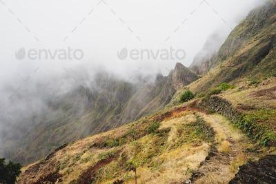 Santo Antao, Cape Verde. Mountain ridge covered in fog on the hike to Xoxo in the Ribeira da Torre