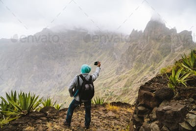 Santo Antao Island, Cape Verde. Travel hiker making picture of arid mountain top in surreal Xo Xo