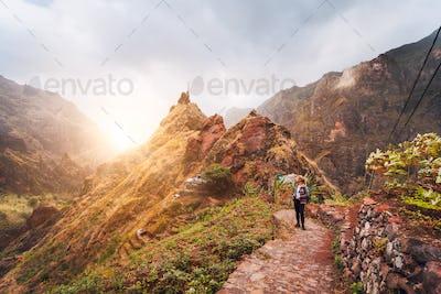 Santo Antao Island Cape Verde. Girl hiking along the trekking route to verdant Xo-Xo valley. Backlit