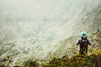 Man tourist with backpack enjoying valley rural landscape on hike path at Santo Antao Island, Cape
