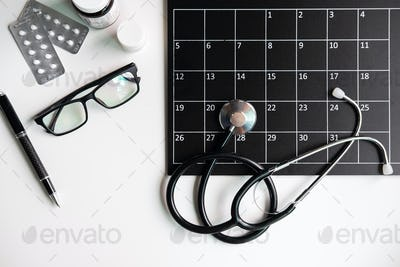 Stethoscope with calendar, medical appointment reminder and annual checkup concept, Top view
