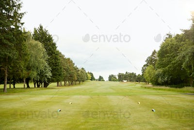 View Along Empty Fairway On Golf Course From Tee