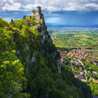 San Marino, medieval tower on a rocky cliff and panoramic view of Romagna