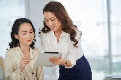Showing business document to colleague