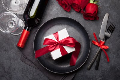 Valentines day card with gift box, wine and roses