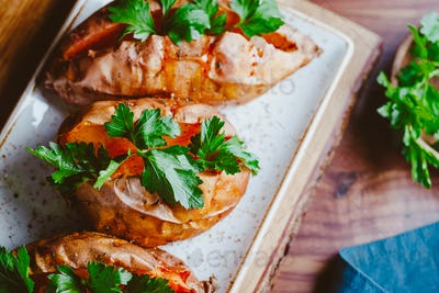 Baked three sweet potatoes with fresh parsley