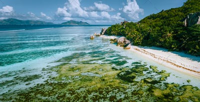 Aerial panoramic view of Anse Source d'Argent beach at La Digue island, Seychelles in the