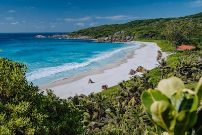 Grand Anse beach at La Digue island in Seychelles from view point above. White sandy beach with blue