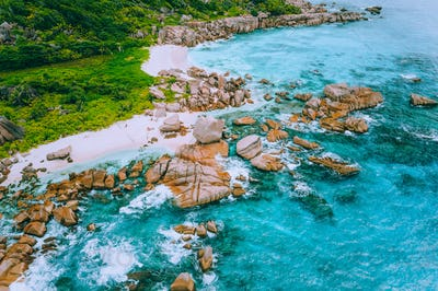 Aerial drone photo of group of rocks on tropical hidden secret beach Marron at La Digue island