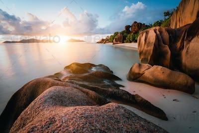 Dreamy sunset at the gorgeous exotic Anse Source d'Argent beach, La Digue island, Seychelles