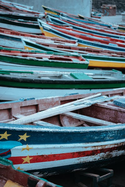 Multicolored local fishing boats waiting on the coast of good weather. Ponta do Sol Santo Antao Cape