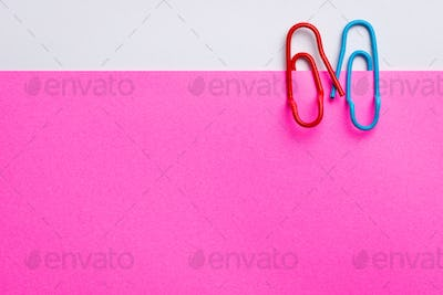 Lovely couple of paper clips on pink paper