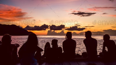Travelers, Divers chilling at the Pier on Sunset, Kri Island. Raja Ampat, Indonesia, West Papua