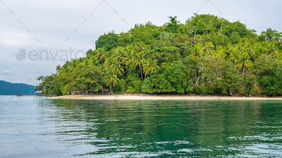 Pier and local Bamboo Huts on the Beach, Friwen Island, West Papuan, Raja Ampat, Indonesia