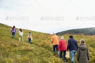 Rear View Of Multi-Generation Family Walking In Countryside With Fishing Nets On Winter Vacation