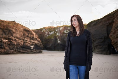 Portrait of a woman walking by Playa Catedrales in Galicia